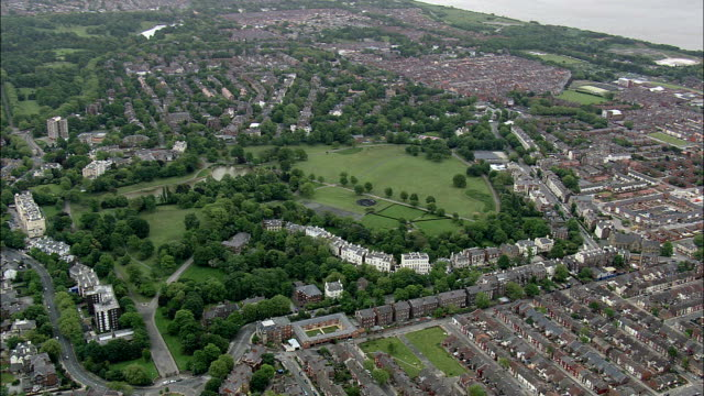 princes park,  liverpool  - aerial view - england,  liverpool,  helicopter filming,  aerial video,  cineflex,  establishing shot,  united kingdom - liverpool england stock videos & royalty-free footage