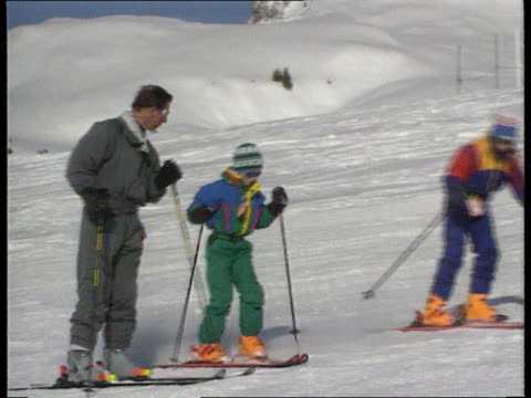 Princes' skiing holiday LTMS Prince Charles with Harry and William skiing down towards MS Prince Charles skiing towards PULL OUT ditto and stops and...