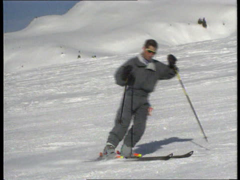 princes' skiing holiday; ltms prince charles with harry and william skiing down towards