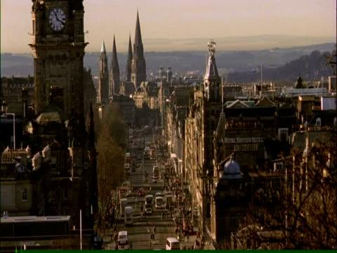 WA Princes Street spires and roofs, clock tower and Scottish flag, Edinburgh, Scotland