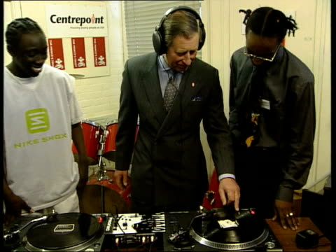 prince's trust 25th anniversary anat joyce london int ms prince charles the prince of wales putting on headphones as trying hand at being dj during... - principe carlo principe del galles video stock e b–roll