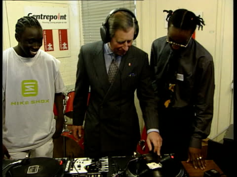 prince's trust 25th anniversary royal london prince charles the prince of wales meeting residents beside record decks during visit to centre run by... - 25th anniversary stock videos & royalty-free footage