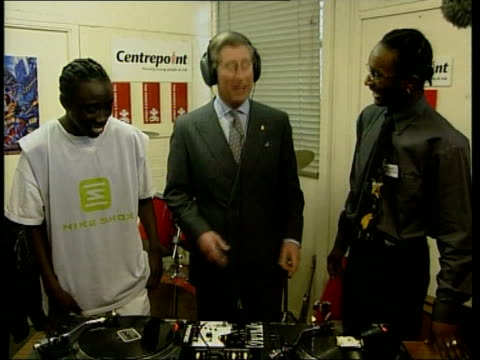 prince's trust 25th anniversary; royal pool england: london: prince charles standing at record decks as takes off headphones tx 13.3.2001/nat - プリンスズトラスト点の映像素材/bロール