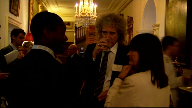 Prince's Trust 35th Anniversary Prince Charles hosts reception at Clarence House Brian May speaking with other guest / Rod Stewart and Penny...