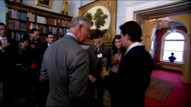 prince's trust 35th anniversary: prince charles hosts reception at clarence house; more of prince charles meeting guests, including gemma arterton... - jools holland stock-videos und b-roll-filmmaterial