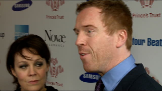 prince's trust celebrate success awards 2013: arrivals; dynamo interview sot lewis and actress wife helen mccrory speaking to media damien lewis... - ヘレン マックローリー点の映像素材/bロール