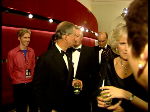 Fashion and pop event to raise funds POOL Prince of Wales talking with boy band Blue CMS Prince Charles and Camilla Parker Bowles backstage CMS...