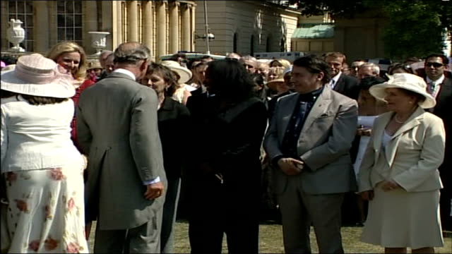 celebrities england london buckingham palace ext prince charles greeting guests at garden party to celebrate princes trust volunteers including rod... - alan titchmarsh stock-videos und b-roll-filmmaterial