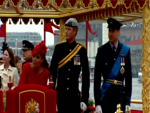 Princes William and Harry and the Duchess of Cambridge watch the Thames Diamond Jubilee Pageant from royal barge Gloriana
