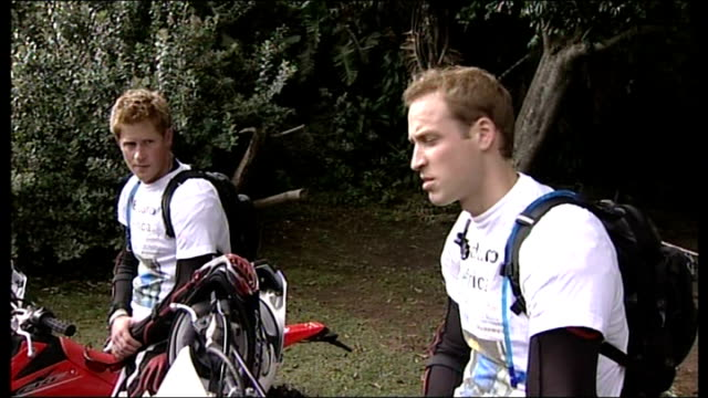 princes william and harry take part in motorbike rally for charity; prince william interview sot - it's a mixture of adventure and charity - the key... - erinnerung stock-videos und b-roll-filmmaterial