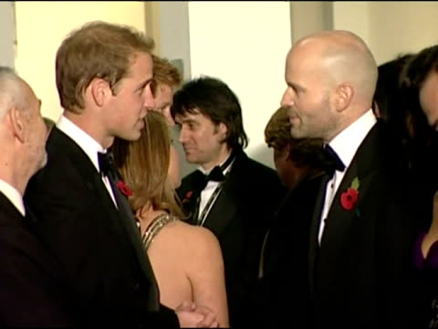 Princes William Harry talk and laugh with cast members of Quantum of Solace
