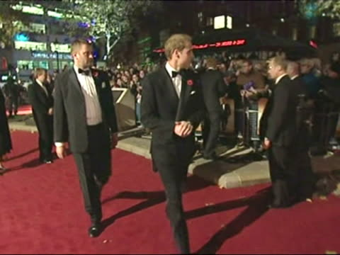 Princes William Harry talk and laugh with members of the Armed Forces at the premiere of Quantum of Solace