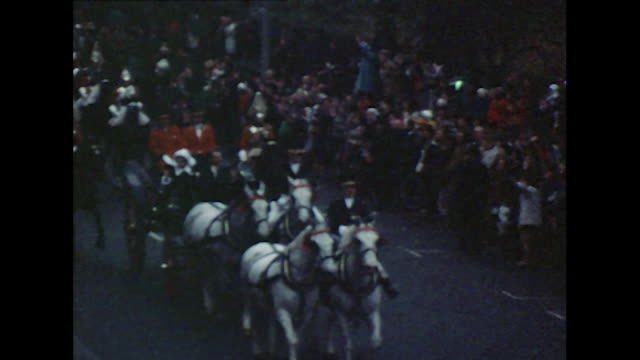 princess anne and mark phillips in an open horse drawn carriage escorted by horse guards with cheering crowds - hooved animal stock videos and b-roll footage