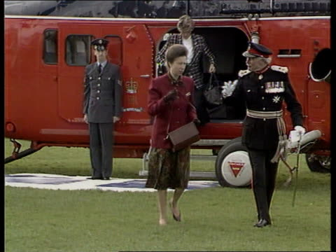 divorce:; b)c4n england: hampshire: lms princess anne with officer in ceremonial uniform as walks towards from helicopter lms princess and officer... - divorce stock videos & royalty-free footage
