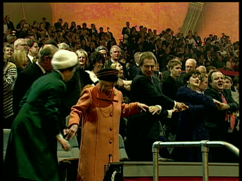 princess anne prince philip queen tony and cherie blair hold hands and sing auld lang syne inside millennium dome on millennium eve; 31 dec 99 - the o2 england stock videos & royalty-free footage