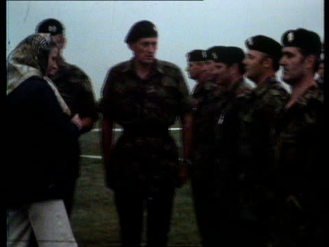 MS Princess Anne walking RightLeft in head scarf and trousers accompanied by Officer MS Troops in line present arms MS Side Princess Anne presents...