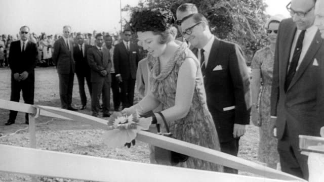 princess beatrix visits dutch west indies / aerial of town of curacao / princess beatrix touring a children's orphanage / princess cutting ribbon on... - anno 1958 video stock e b–roll