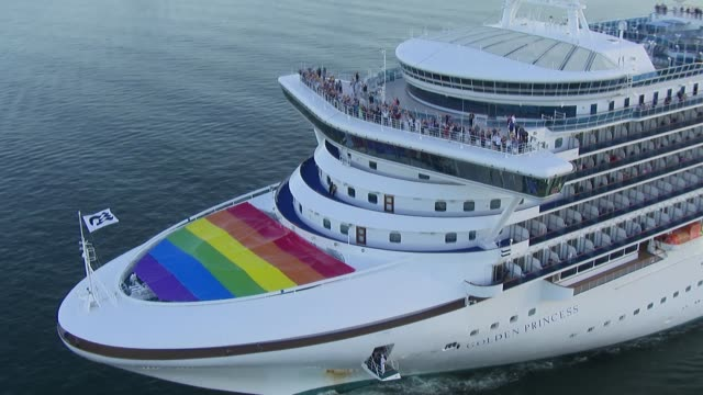 princess cruises' 2600passenger golden princess sailed into sydney today with a huge rainbow flag covering the front deck to coincide with the... - ponte di una nave video stock e b–roll