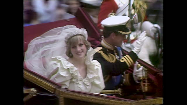 princess diana and prince charles wave from their coach on the day of their wedding; 1981. - symbol stock videos & royalty-free footage
