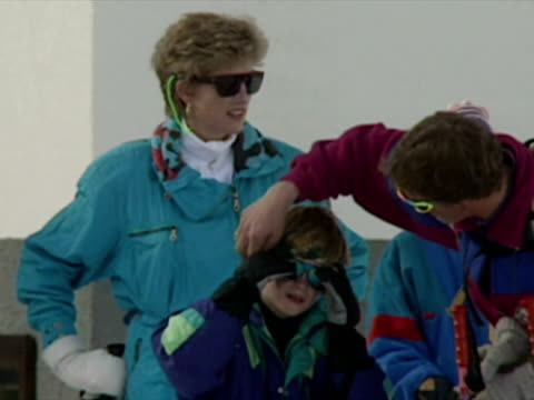 princess diana and princes william and harry skiing across to ski lifts - 1994 stock-videos und b-roll-filmmaterial