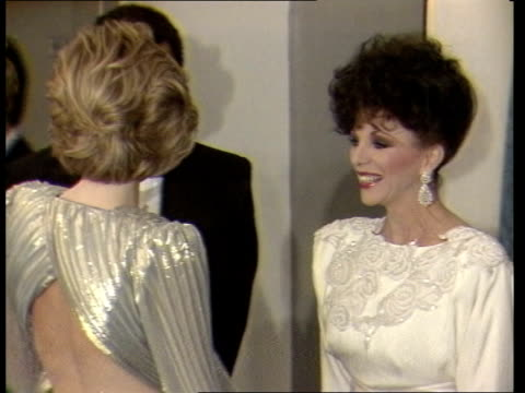 princess diana attends grosvenor house hotel fashion show england london grosvenor house int diana princess of wales along and greeting joan collins... - fashion stock videos & royalty-free footage