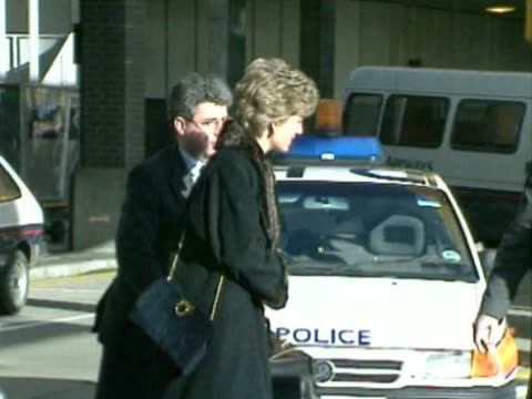 Princess Diana boards Concorde flight to New York on frosty morning / Dressed in warm coat she steps out of car into Heathrow service door to board...