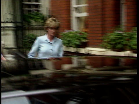 Princess Diana charity resignations NAO London MS Princess of Wales along towards as press photographers nearby R03129301 ITN INT Hilton Hotel SEQ...