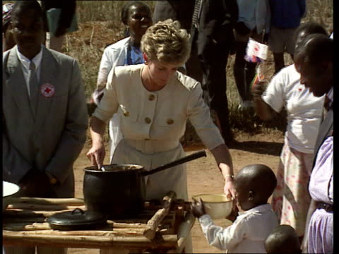 Princess Diana charity resignations TX 12793 ITN EXT ZIMBABWE SEQ Princess touring village and serving food from large pot FREEZE Dec 1993 SEQ...