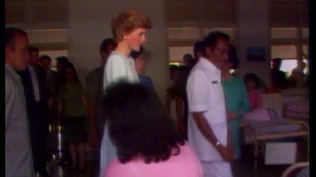 princess diana death 20th anniversary eve: princes william and harry visit kensington palace memorial garden; bsp041189011 / 4.11.1989 indonesia:... - princess stock videos & royalty-free footage