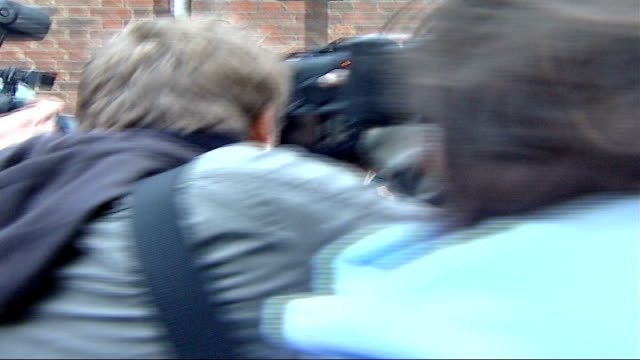 Princess Diana death inquest to be heard before a jury 912007 EXT Kate Middleton getting into car surrounded by press scrum DISSOLVE