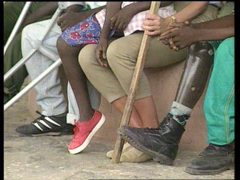 Princess Diana Death LIB ANGOLADiana sitting with landmine victims