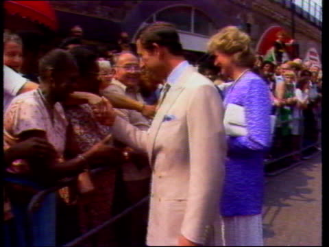 Princess of Wales Ethnic LIB Brixton Charles and Diana along line of people shaking hands Int Diana throws basketball through hoop to applause