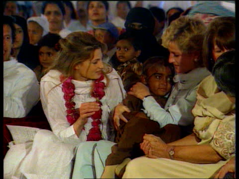 princess of wales: ethnic; lib pakistan: lahore: shaukat khanum hospital diana and jemima khan sitting with crowd of patients diana hugging small girl - lahore pakistan stock videos & royalty-free footage
