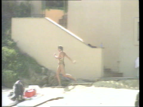 princess diana french newspaper interview; c5n: r15079701/itn france: st tropez: diana down stairs and onto beach - swimming costume stock videos & royalty-free footage