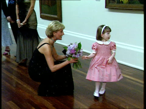 Princess Diana Holiday LIB London Tate Gallery Int Diana accepting bouquet from small girl during fund raising reception for her 36th birthday and...