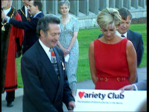 Holiday wih Dodi Fayed R21079707/ITN North London Northwick Park Hospital Diana in red with hospital officials receiving a cheque for the hospital...