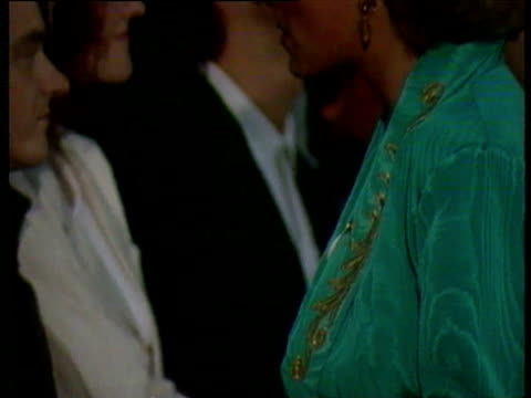 princess diana in green outfit chatting to musicians in line up at prince's trust concert / she talks to singer alison moyet / prince charles... - 1987 bildbanksvideor och videomaterial från bakom kulisserna