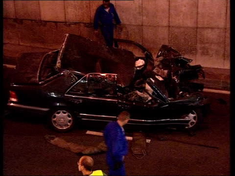 Stevens visits Paris LIB Investigators examining car wreckage Police around wreckage of car