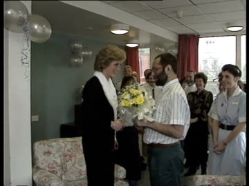 princess diana is presented with bouquet of flowers by patient at an aids hospital mildmay mission - aids stock videos & royalty-free footage