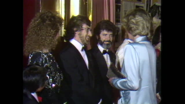 """princess diana meets steven spielberg at the royal charity premiere of """"indiana jones & the temple of doom"""" in leicester square. - film premiere stock videos & royalty-free footage"""