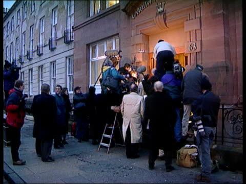 press coverage lib scotland glasgow scrum of press outside entrance to carlton buildings - スクラム点の映像素材/bロール