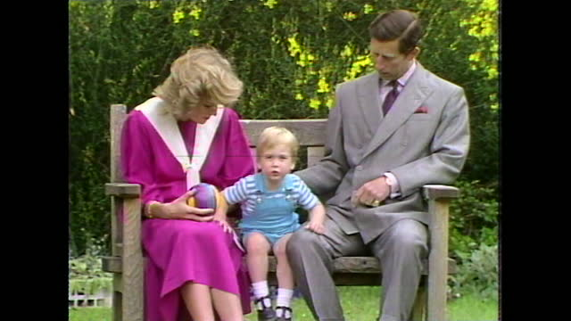 princess diana, prince charles and prince william sit on a garden bench together during a photocall, then prince william gets up and runs past line... - toddler stock videos & royalty-free footage