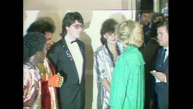 princess diana shakes hands with tracey ullman and mike read while attended a pop concert at the royal albert hall. - fame stock videos & royalty-free footage
