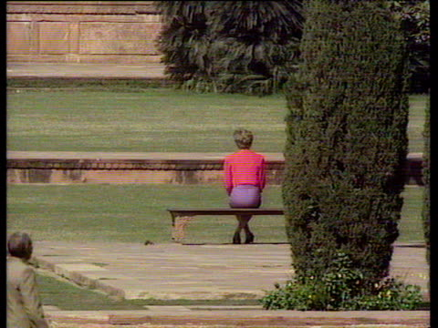 princess diana sits on bench in grounds of taj mahal with back to press and cameras india 11 feb 92 - taj mahal stock videos and b-roll footage