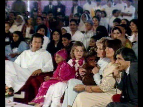 princess diana sits with imran and jemima khan and their family watching young girls dance and cradling sick child in her arms lahore; 22 feb 96 - sportlerin stock-videos und b-roll-filmmaterial