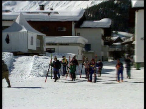 princess diana skiing privacy naf lech gv mountains in b/g with buildings in front and royal party walking towards zoom in ditto as princess of wales... - skiing stock videos & royalty-free footage