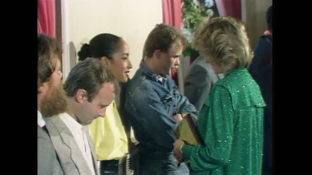 princess diana talks to sade and phil collins while attended a pop concert at the royal albert hall. - royal albert hall stock videos & royalty-free footage
