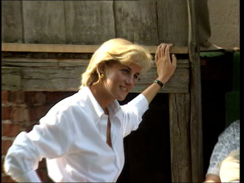 second part broadcast on US television LIB HERZEGOVINA Dobrinia Diana leaning against house as smiling ZOOM