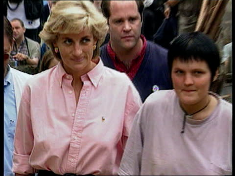 Princess Diana visit LIB Diana walking towards with others including landmine victim on crutches