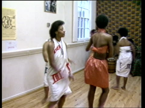 princess diana visits cultural centre princess diana visits cultural centre england birmingham handsworth ms ghanaian tribal band sof ms band member... - braided hair stock-videos und b-roll-filmmaterial